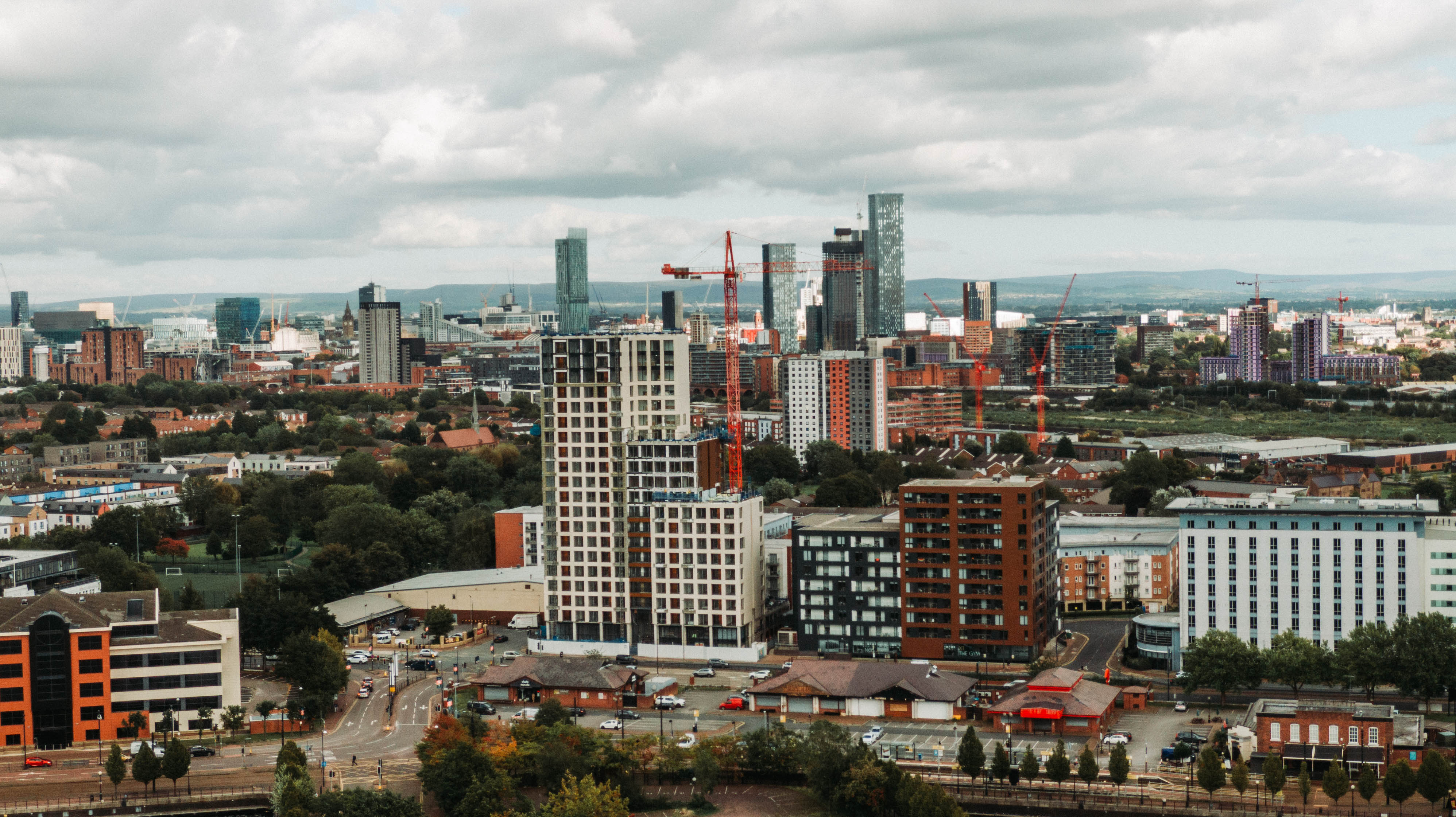 New Gateway building with Manchester skyline in backdrop